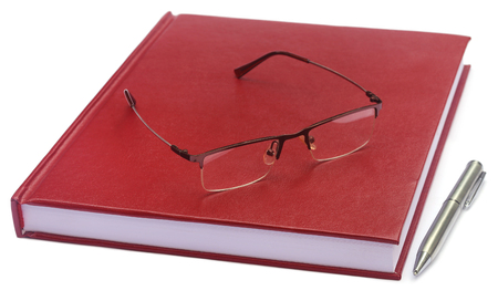 thesis: Maroon colored thesis paper with spectacles over white background