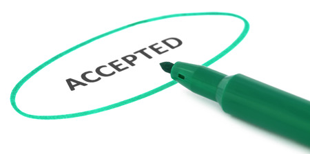 accepted: ACCEPTED written in a white paper with green signature pen Stock Photo