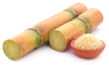 Fresh red sugarcane with sugar over white background Stock Photo