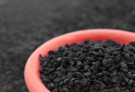nigella seeds: Nigella or Black cumin in a bowl
