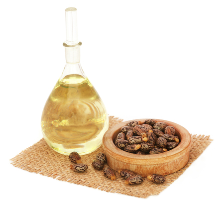 triglycerides: Castor oil with beans on sack over white background