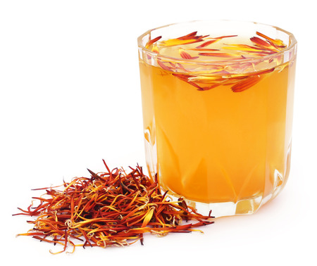 extract: Herbal calendula flower with extract in a glass over white background