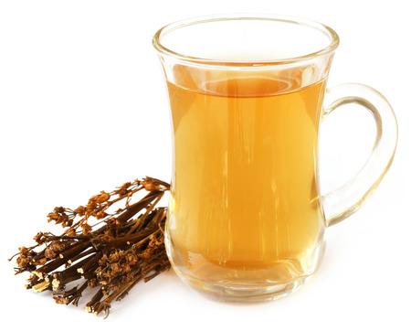 ayurvedic: Ayurvedic medicinal Chirata with herbal juice over white background Stock Photo