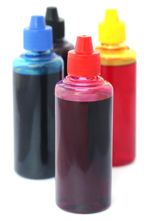 printer ink: Printer ink bottles over white background Stock Photo