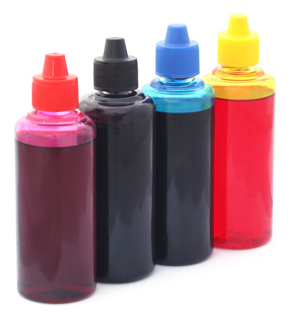 computer printer: Printer ink bottles over white background Stock Photo