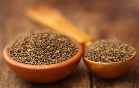 ajwain: Ajwain seeds in bowl and wooden spoon