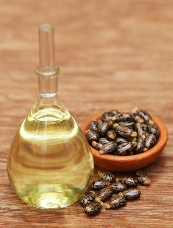 castor: Castor beans and oil in a glass jar