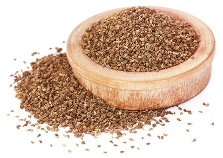 Ajwain seeds in a wooden bowl Stock Photo