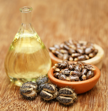 triglycerides: Castor beans and oil in a glass jar