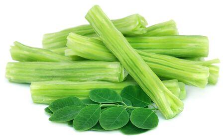 Edible moringa oleifera with green leaves over white background Stock Photo