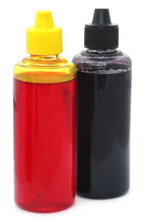 printer ink: Two printer ink bottles over white background