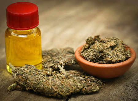 Medicinal cannabis with extracted oil in a bottle Stock Photo