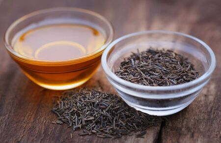 caraway: Caraway seeds with essential oil in glass bowl Stock Photo
