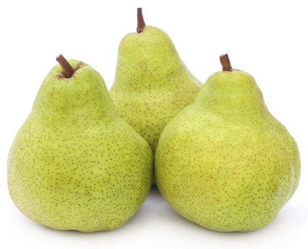 Fresh pears over white background Фото со стока
