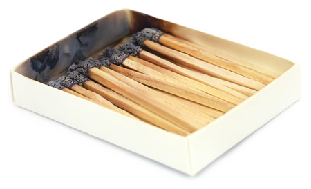 burnt: Burnt matchsticks over white background