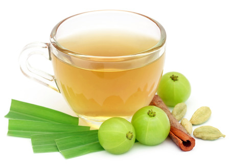 lemongrass tea: Herbal tea in a cup with different herbs over white background