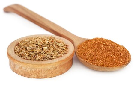 Crushed cumin with whole ones over white background Stock fotó