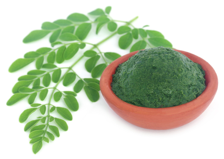 Edible moringa leaves with ground paste in a pottery Stock Photo