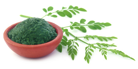 malunggay: Edible moringa leaves with ground paste in a pottery Stock Photo