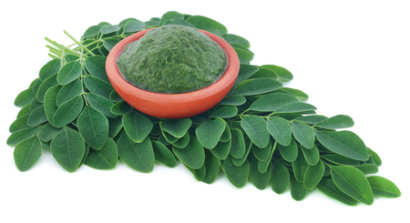 sonjna: Edible moringa leaves with ground paste in a pottery Stock Photo