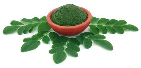 marango: Edible moringa leaves with ground paste in a pottery Stock Photo