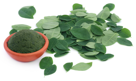 nebeday: Edible moringa leaves with ground paste in a pottery Stock Photo