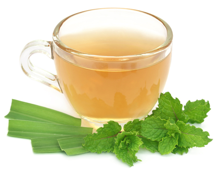 lemongrass tea: Herbal tea in a cup with herbs over white background Stock Photo