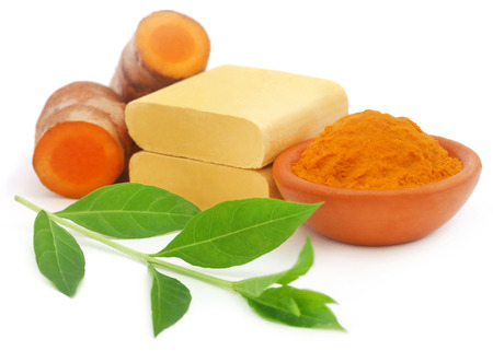 Turmeric with other herbal products for beautification over white background Stock Photo