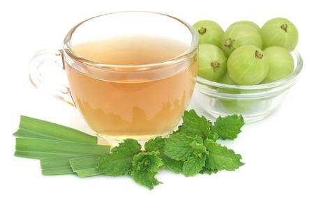 lemongrass tea: Herbal tea with amla and lemon grass over white background