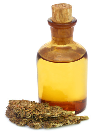 intoxication: Medicinal cannabis with extract oil in a bottle over white background Stock Photo