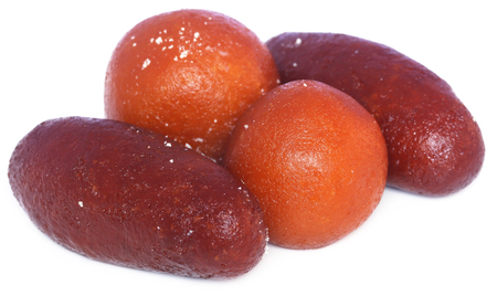 Popular Bangladeshi Sweetmeats Pantua and Kalojam over white background Stock Photo