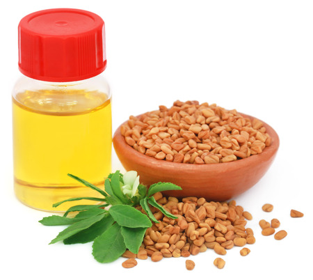 Fenugreek leaves with seeds and oil in a bottle