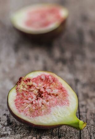 Fresh organic common fig sliced on wooden surface
