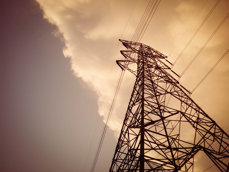 power cables: Electricity Pylon with connecting power cable at evening