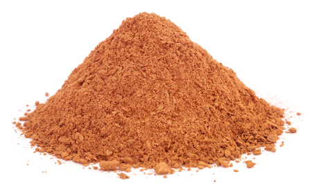 Ground cinnamon over white background