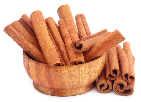 Bunch of some fresh aromatic cinnamon over white background