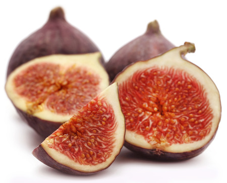 Fresh organic common figs over white background Stock Photo
