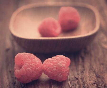 Fresh Raspberry on wooden surface