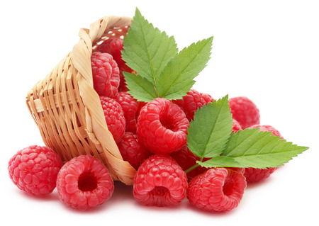Fresh Raspberry in a basket over white background Stock Photo
