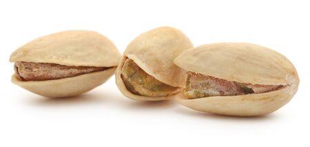 Closeup of pistachio over white background