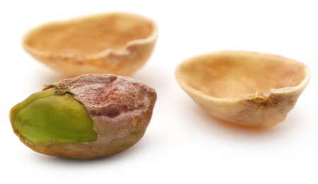 Closeup of fresh organic pistachio over white background