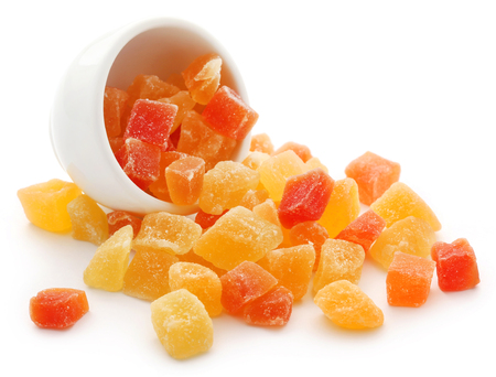 Dried fruits apricot and papaya with some others in a bowl over white Stock Photo