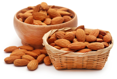 Organic almonds over white background
