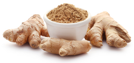 Ginger with dried powder over white background