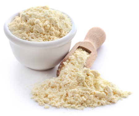 Gram flour closeup over white background Фото со стока