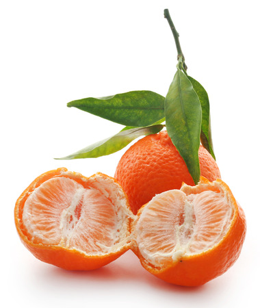 Fresh orange with green leaves over white background