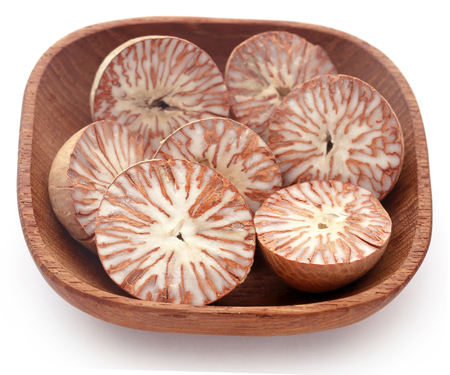 Betel nuts in a bowl over white background Stock Photo