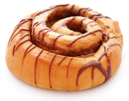 Close up of a cinnamon bun isolated against white background