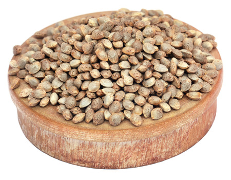 Medicinal cannabis seeds in a wooden bowl Stock Photo