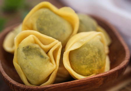 Italian Tortelloni made of flour with spinach and other ingredients Stock Photo